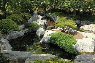 Koi pond designs pond shape building a koi pond for Japanese koi pond garden design